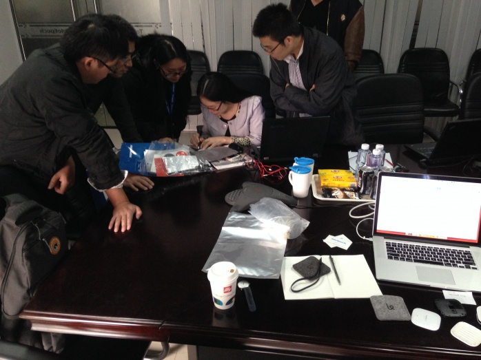 Sjoerd discusses samples with the Chinese manufacturing team